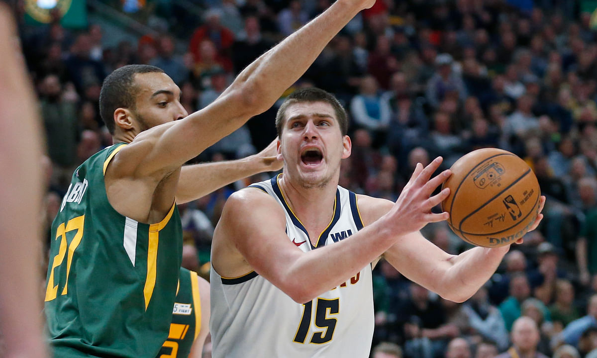 Utah Jazz center Rudy Gobert (27) defends against Denver Nuggets center Nikola Jokic.