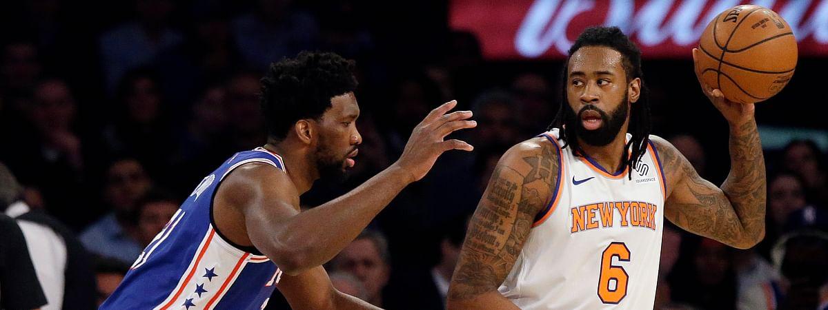 Philadelphia 76ers' Joel Embiid, left, defends New York Knicks' DeAndre Jordan, Wednesday, Feb. 13, 2019, in New York. Next year, Jordan will play across the river in Brooklyn. (AP Photo/Frank Franklin II)