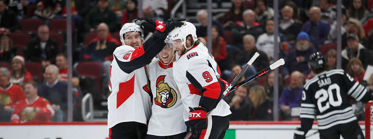 Bobby Ryan is congratulated by teammates after one of the Senators' seven goals Monday