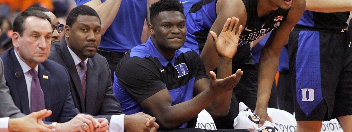 Duke's Zion Williamson, center, cheers after a basket from the bench. (Nick Lisi)