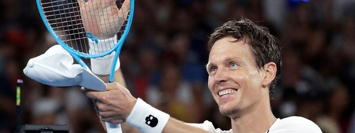 Tomas Berdych  celebrates during the Australian Open in Melbourne, Friday, Jan. 18, 2019. (AP Photo/Aaron Favila)