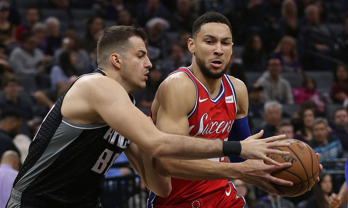 Philadelphia 76ers guard Ben Simmons, right, drives to the basket against Sacramento Kings forward Nemanja Bjelica, left, during the first quarter of an NBA basketball game Saturday, Feb. 2, 2019, in Sacramento, Calif. (AP Photo/Rich Pedroncelli)