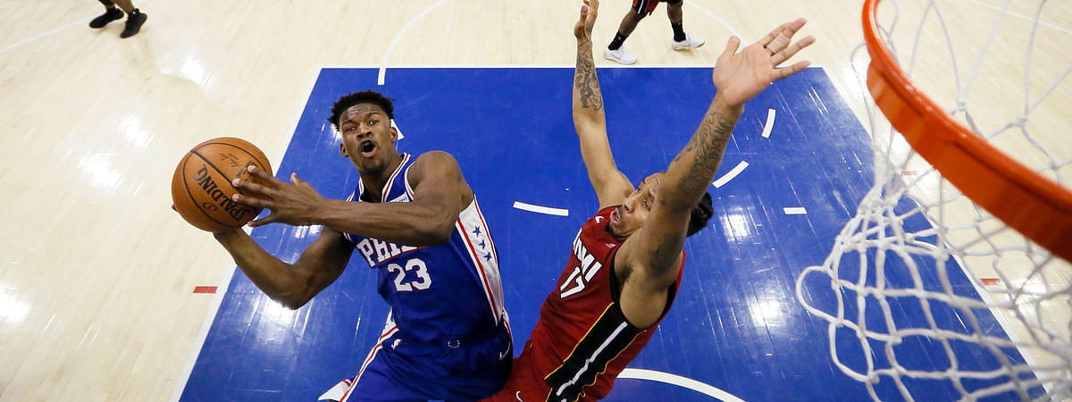 Sixers' Jimmy Butler drives on Heat's RodneyMcGruder Thursday (Matt Slocum)