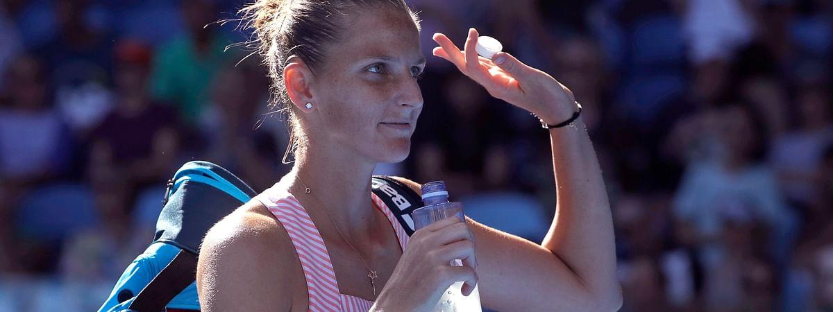 Karolina Pliskova of the Czech Republic waves at the Australian Open tennis championships, Monday, Jan. 21, 2019. (AP Photo/Mark Schiefelbein)