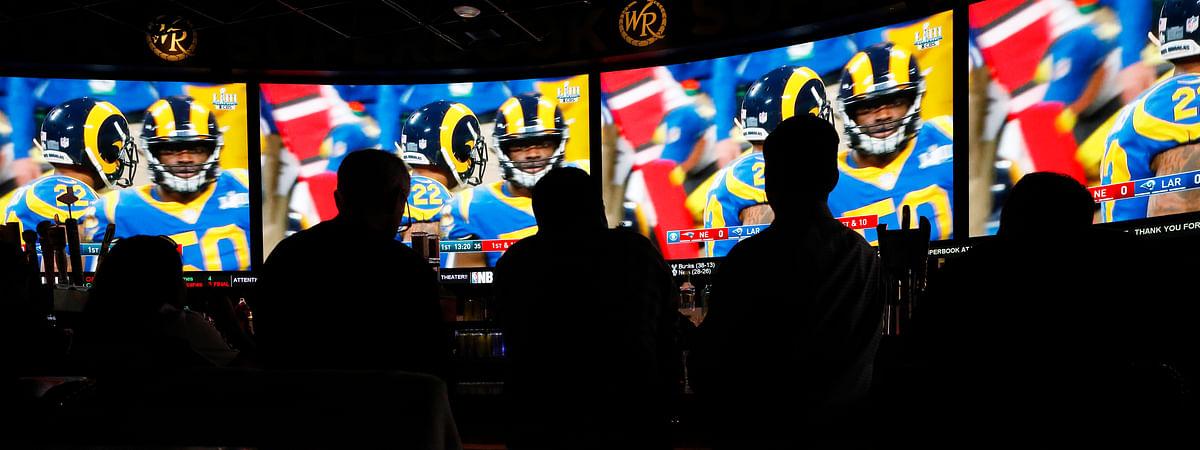 People watch Super Bowl LIII at the Westgate Superbook sports book, Sunday, Feb. 3, 2019, in Las Vegas. (AP Photo/John Locher)
