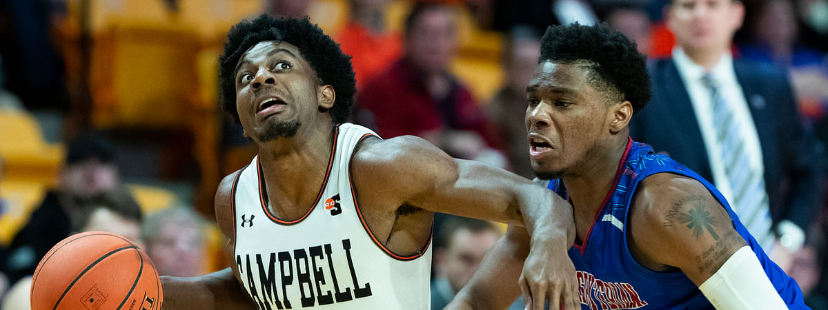 Campbell's Chris Clemons drives against Presbyterian College's Chris Martin in a January game (jason E. Miczek)