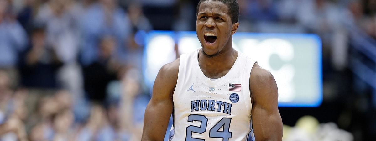 North Carolina's Kenny Williams (24) reacts following a 3-point basket  against Miami in Chapel Hill, N.C., Saturday, Feb. 9, 2019. (AP Photo/Gerry Broome)