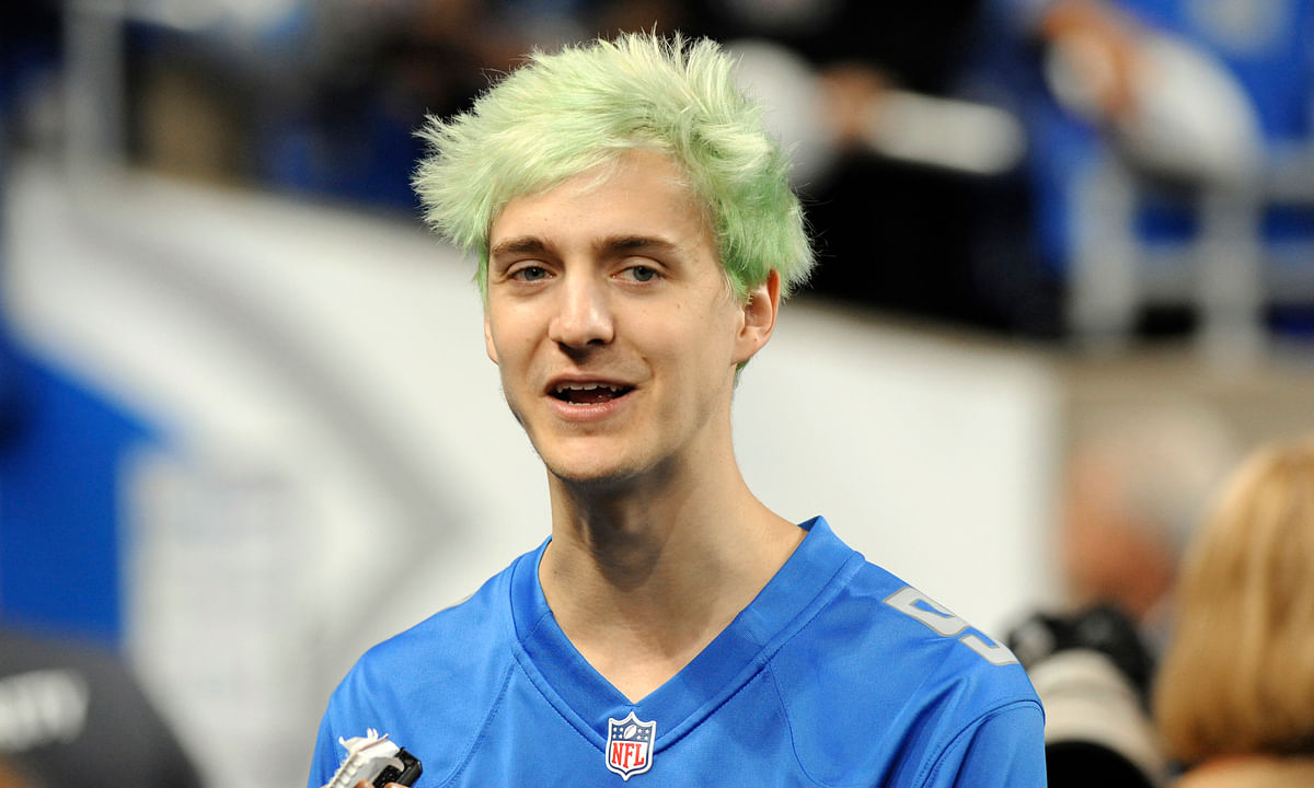 "Tyler ""Ninja"" Blevins before an NFL football game between the Detroit Lions and New York Jets in Detroit. Blevins has the emergence of an 18-year-old ""Apex"" superstar. (AP Photo/Jose Juarez, File)"