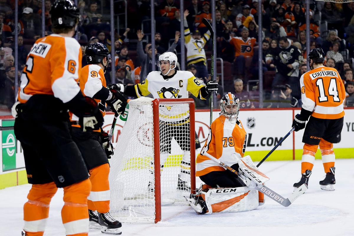 Penguins' Sidney Crosby (87) celebrates celebrates goal Monday amidst the Flyers