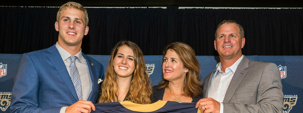 CORRECTS TO NANCY GOFF-File-This April 29, 2016, file photo shows California's Jared Goff posing for photos with his family after being selected by the Los Angeles Rams as the first pick in the first round of the NFL football draft, in Los Angeles. From left, Jared Goff with sister, Lauren Goff and parents, Nancy Goff and Jerry Goff. The Montreal Expos would be thrilled with this Super Bowl, and those who used to be part of the extinct baseball franchise's evaluation process certainly are, even all these years later. Gone from the game for nearly 15 years, the former club has ties to both quarterbacks in Sunday's NFL championship game. The Expos traded for Jared Goff's father, Jerry, nearly three decades ago. Goff made his major league debut for Montreal in 1990 and played 55 games for the team as a backup catcher that year and in 1992. (AP Photo/Damian Dovarganes, File)
