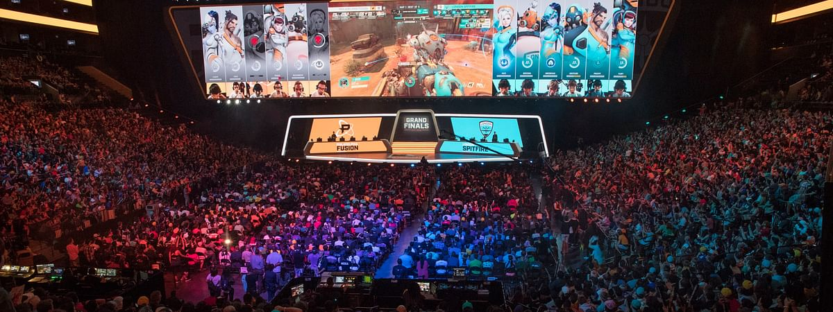 In this July 28, 2018, file photo, fans watch the competition between Philadelphia Fusion and London Spitfire during the Overwatch League Grand Finals competition at Barclays Center in Brooklyn. (AP Photo/Mary Altaffer, File)