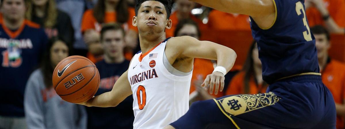 Virginia guard Kihei Clark tries to get the ball down court as Notre Dame guard Prentiss Hubb defends. (AP Photo/Steve Helber)