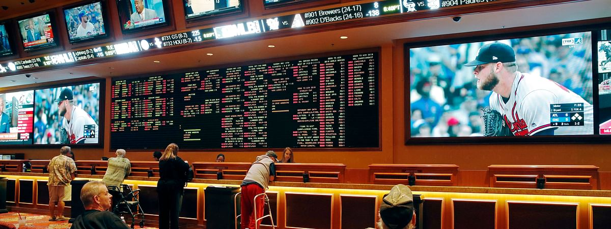 People make bets in the sports book at the South Point hotel and casino in Las Vegas. (AP Photo/John Locher, File)