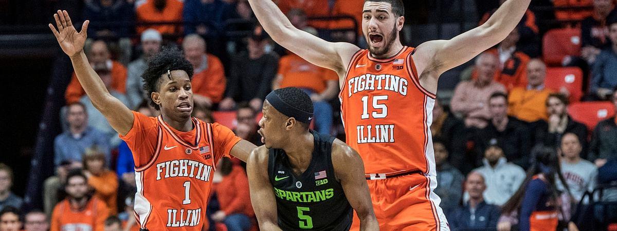 Illinois' Trent Frazier (1) and Giorgi Bezhanishvili (15) pressure Michigan State's Cassius Winston (5) in Champaign, Ill., Tuesday, Feb. 5, 2019. (AP Photo/Rick Danzl)