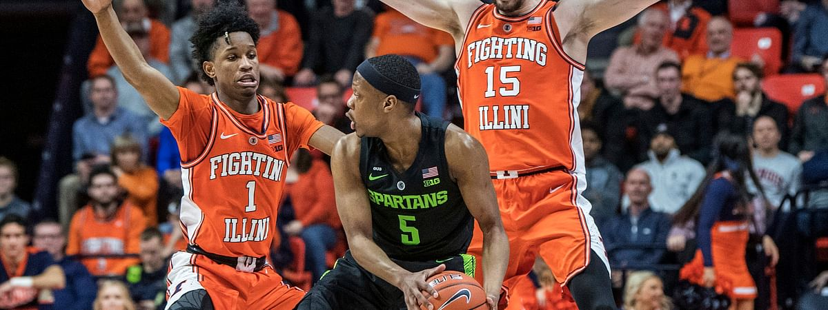 In this February 2019 file photo, Illinois' Trent Frazier (1) and Giorgi Bezhanishvili (15) pressure Michigan State's Cassius Winston (5) in Champaign, Ill.