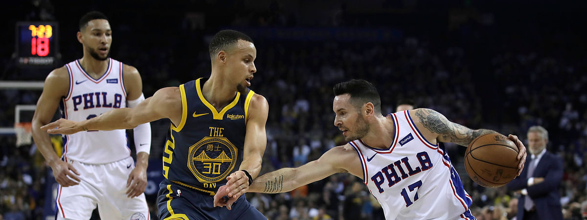 Philadelphia 76ers' JJ Redick, right, works with the ball against Golden State Warriors' Stephen Curry (30) during the first half of an NBA basketball game Thursday, Jan. 31, 2019, in Oakland, Calif. (AP Photo/Ben Margot)
