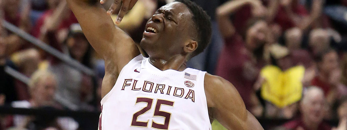 Florida State's Mfiondu Kabengele celebrates after hitting a three-point basket in the first half of an NCAA college basketball game against Louisville. (AP Photo/Steve Cannon)