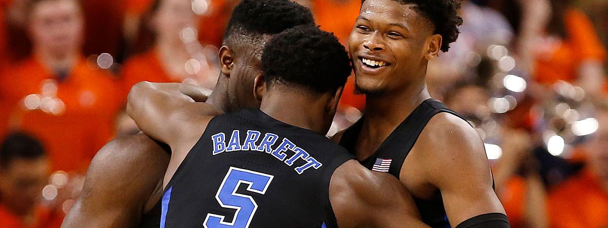 Duke's Zion Williamson, RJ Barrett and Cam Reddish celebrate the team's 81-71 victory over Virginia, Saturday, Feb. 9, 2019. (Mark Gormus/Richmond Times-Dispatch via AP)