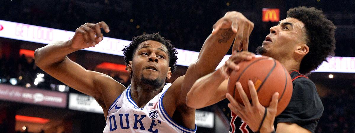 Louisville's Jordan Nwora runs into Duke's Marques Bolden Tuesday