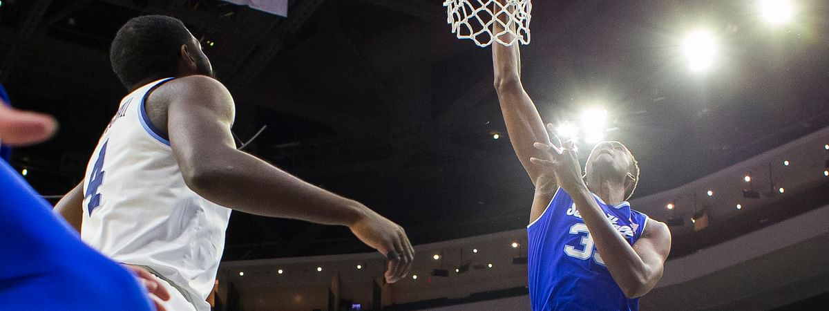 Seton Hall's Romaro Gill, center, dunks as Villanova's Dhamir Cosby-Roundtree, left, and Collin Gillespie, right, defend. (AP Photo/Chris Szagola)