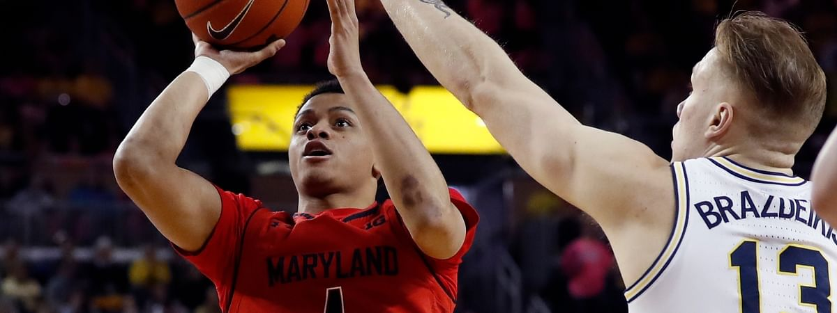 Maryland's Anthony Cowan Jr. shoots over Michigan's Ignas Brazdeikis.