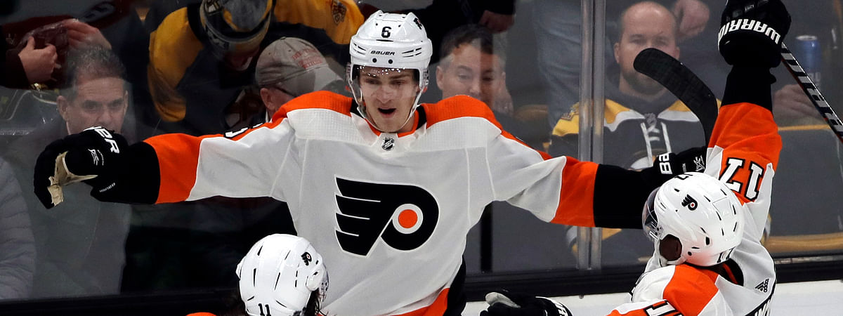 Philadelphia Flyers defenseman Travis Sanheim (6) celebrates his winning goal with teammates Travis Konecny (11) and Wayne Simmonds (17) in the overtime period of an NHL hockey game against the Boston Bruins, Thursday, Jan. 31, 2019, in Boston. (AP Photo/Elise Amendola)
