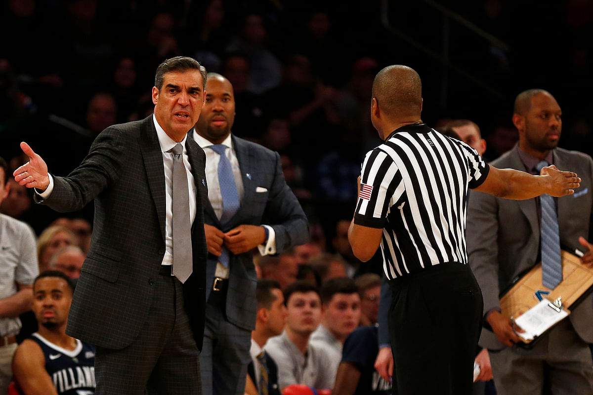 Villanova's Jay Wright discusses a call with a referee in Sunday's loss to St. John's