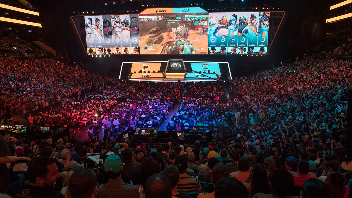 FILE - In this July 28, 2018, file photo, fans watch the competition between Philadelphia Fusion and London Spitfire during the Overwatch League Grand Finals competition at Barclays Center in Brooklyn. (AP Photo/Mary Altaffer, File)