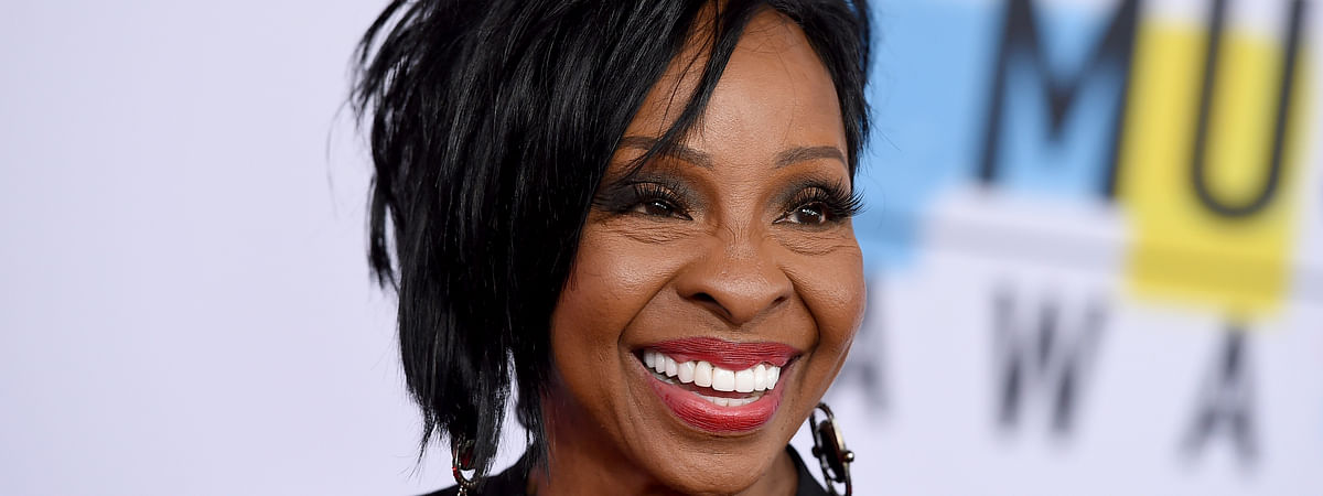 "FILE - In this Oct. 9, 2018 file photo, Gladys Knight arrives at the American Music Awards at the Microsoft Theater in Los Angeles. The seven-time Grammy Award-winner will sing ""The Star-Spangled Banner"" at this year's Super Bowl, Sunday, Feb. 3, 2019. Knight says she's proud to use her voice to ""unite and represent our country"" in her hometown of Atlanta.(Photo by Jordan Strauss/Invision/AP, File)"