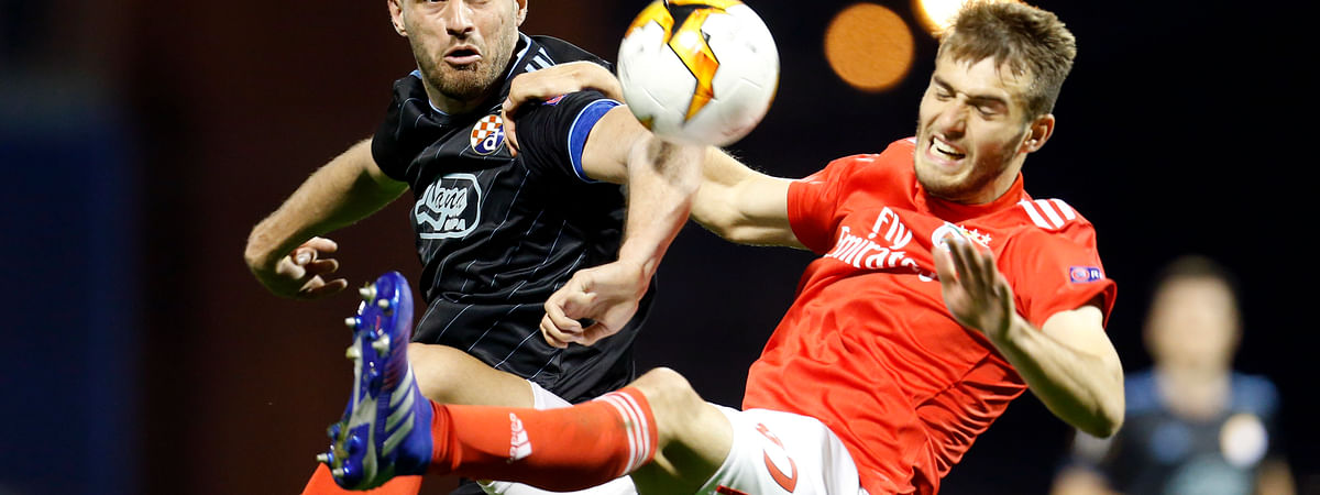 In this March 7, 2019 file photo, Dinamo Zagreb's Bruno Petkovic, left, fights for the ball with Benfica's Francisco Ferreira during the Europa League round of 16.