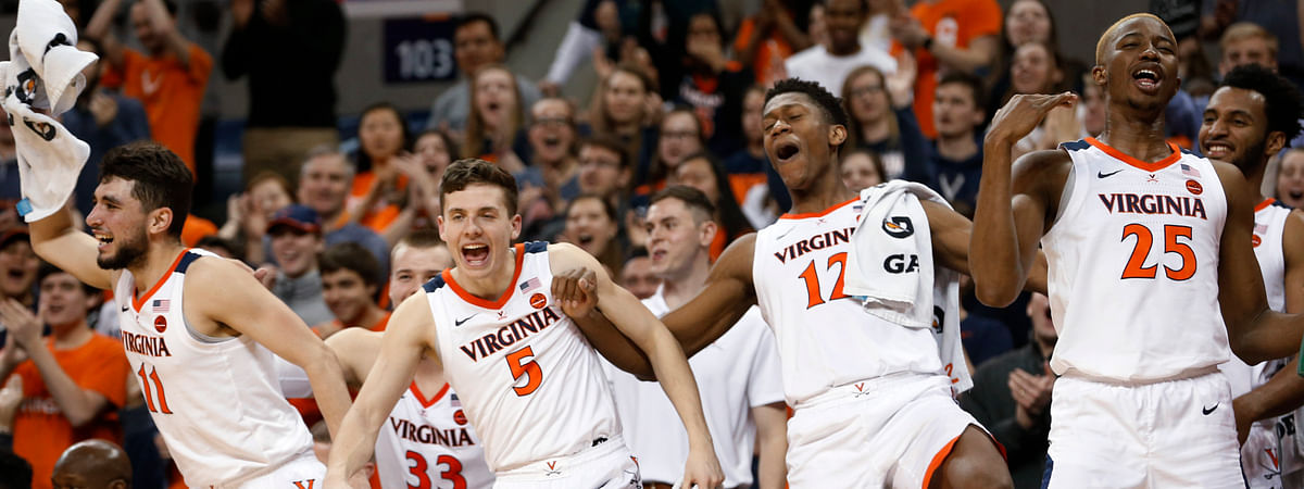 Virginia guard Ty Jerome, left, guard Kyle Guy, guard De'Andre Hunter and forward Mamadi Diakite celebrate during a college basketball game against Georgia Tech. (Steve Helber)