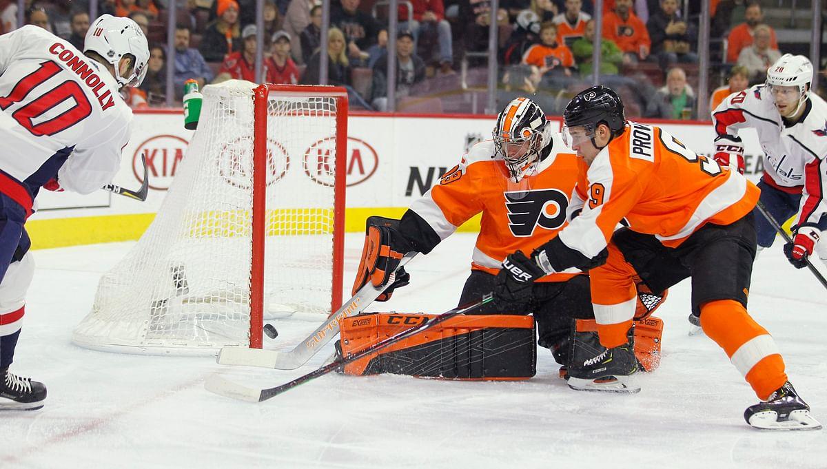 Flyers goalie Carter Hart allows a first-period goal by the Capitals' Brett Connolly Thursday (Tom Mihalek)