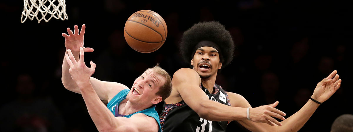 Charlotte's Cody Zeller (left) and Brooklyn's Jarrett Allen battle Friday (Seth Wenig)