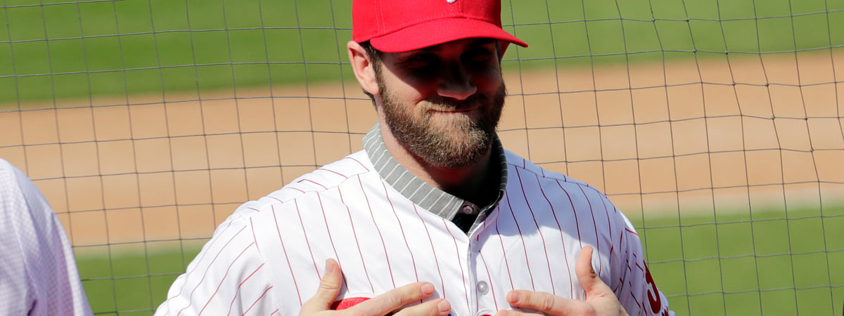 Bryce Harper smiles after putting on a Philadelphia Phillies jersey during a news conference at the team's spring training baseball facility, Saturday, March 2, 2019. (Lynne Sladky)