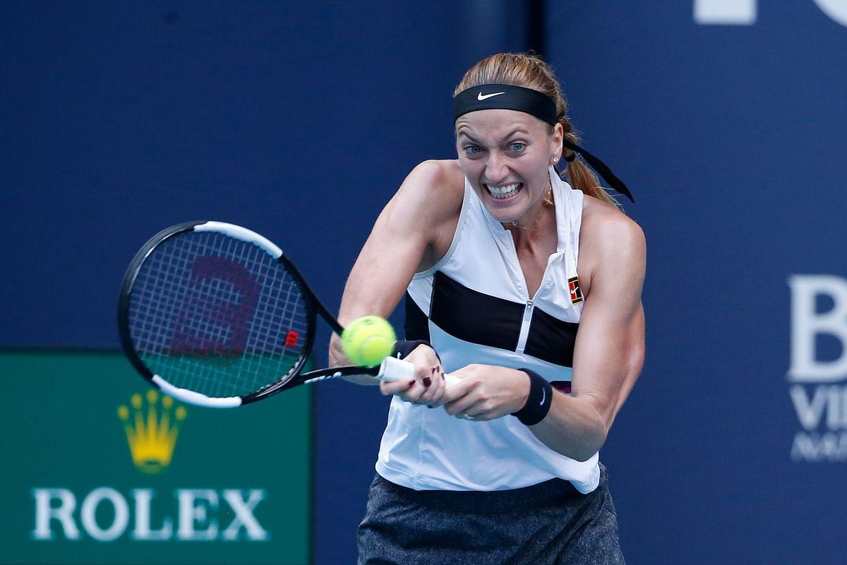 Petra Kvitova returns a volley to Caroline Garcia Monday  (Joel Auerbach)