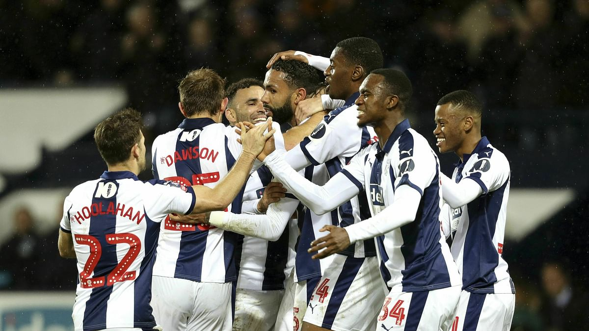 In this Feb. 6, 2019 file photo, West Bromwich Albion's Kyle Bartley, center, celebrates after scoring his side's first goal of the game against Brighton & Hove during an English FA Cup fourth round replay soccer match at The Hawthorns, West Bromwich, England.