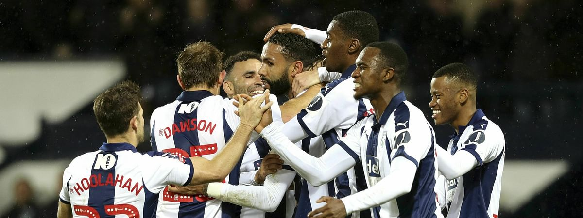 West Bromwich Albion's Kyle Bartley, center, celebrates after scoring his side's first goal of the game against Brighton & Hove during an English FA Cup fourth round replay soccer match at The Hawthorns, West Bromwich, England, on Feb. 6, 2019.