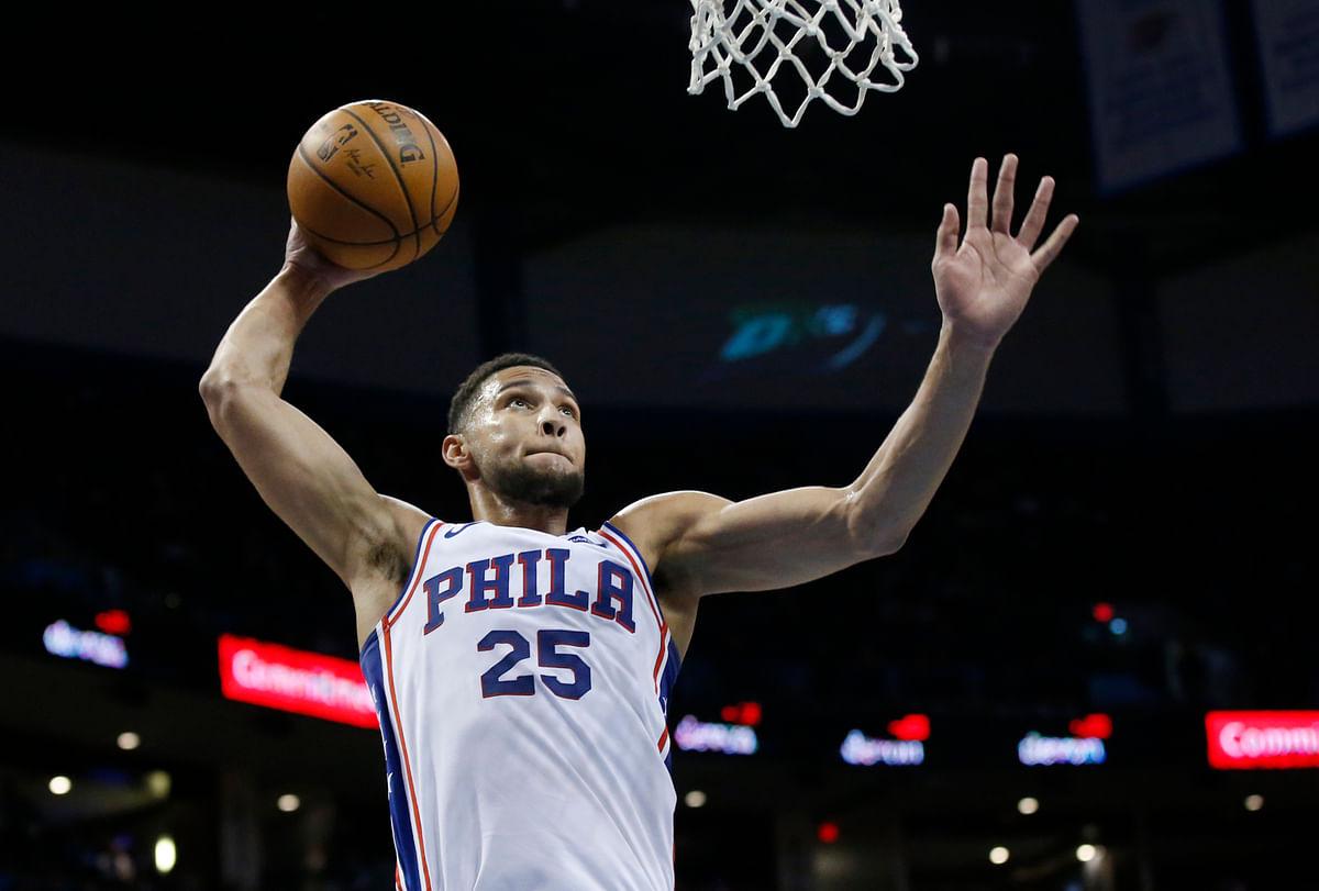 Philadelphia 76ers guard Ben Simmons goes up for a dunk against the Oklahoma City Thunder on Thursday, Feb. 28, 2019, in Oklahoma City. (AP Photo/Sue Ogrocki)
