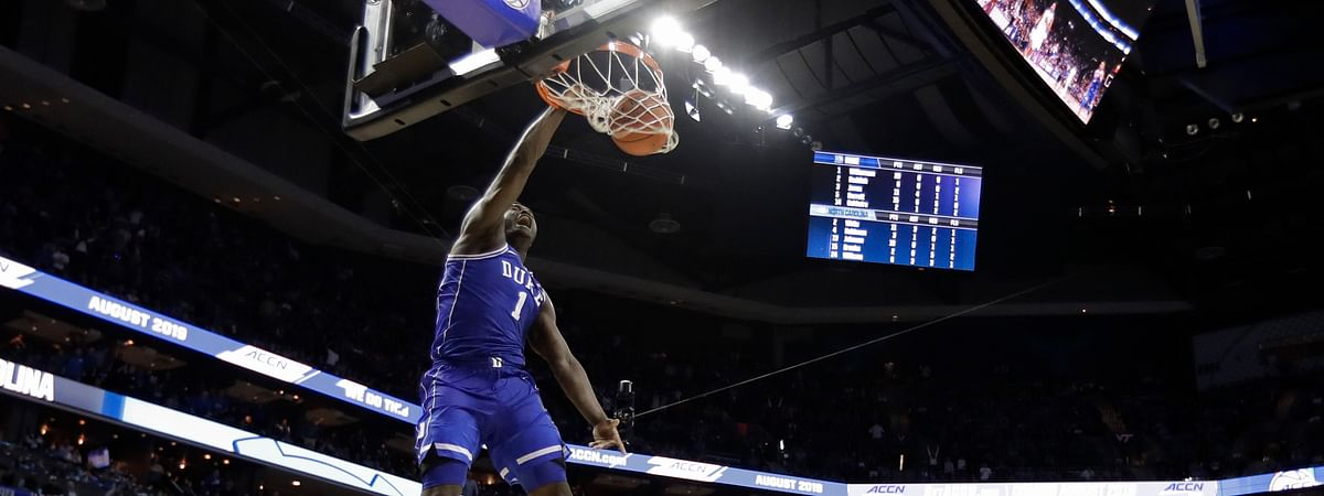 Duke's Zion Williamson  dunks against North Carolina  Friday (Chuck Burton)