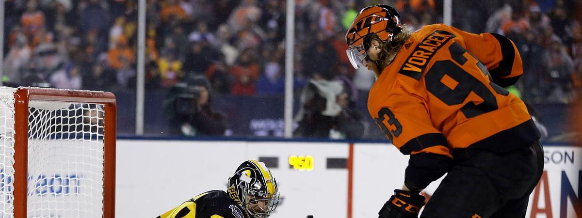 Flyers' Jake Voracek battles in front of the net and Penguins' goalie Matt Murray during the third period of the Stadium Series game on Feb. 23 (Matt Slocum)