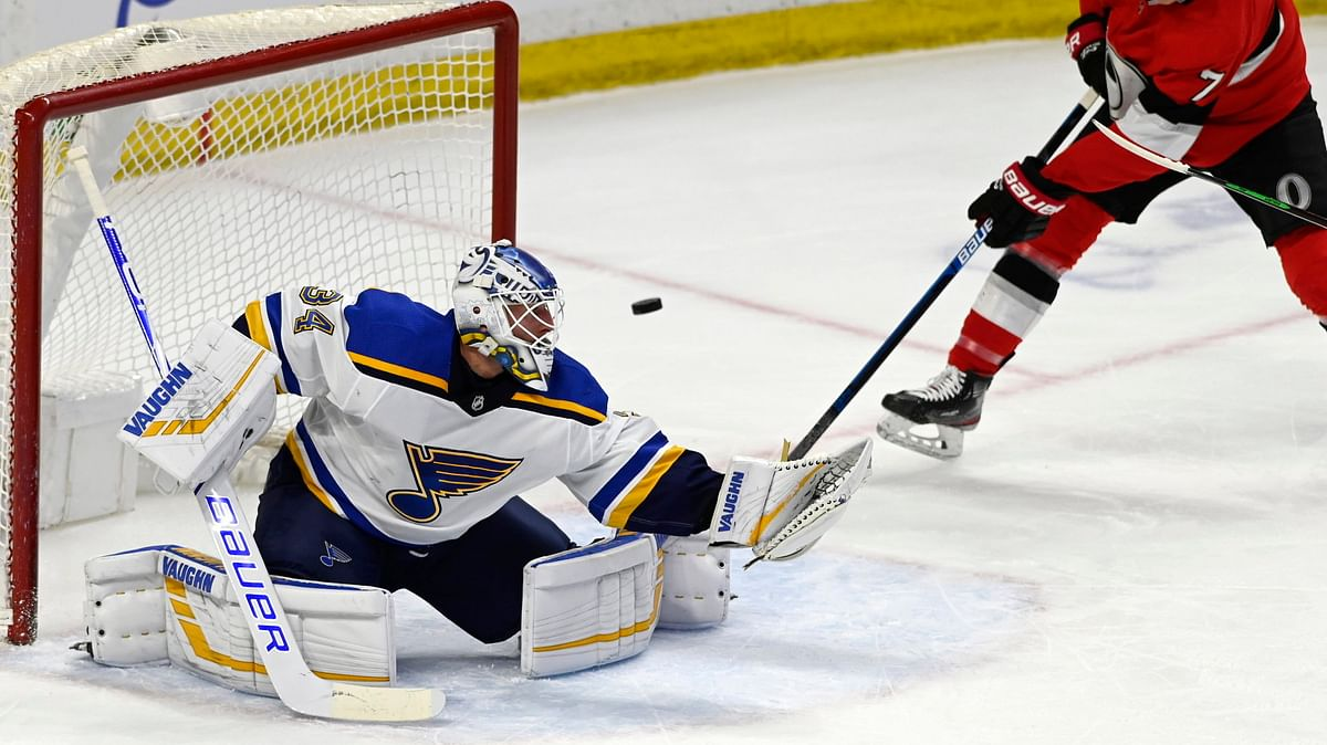 St. Louis goaltender Jake Allen eyeballs  the puck during a game against the Senators Thursday (Justin Tang/The Canadian Press)
