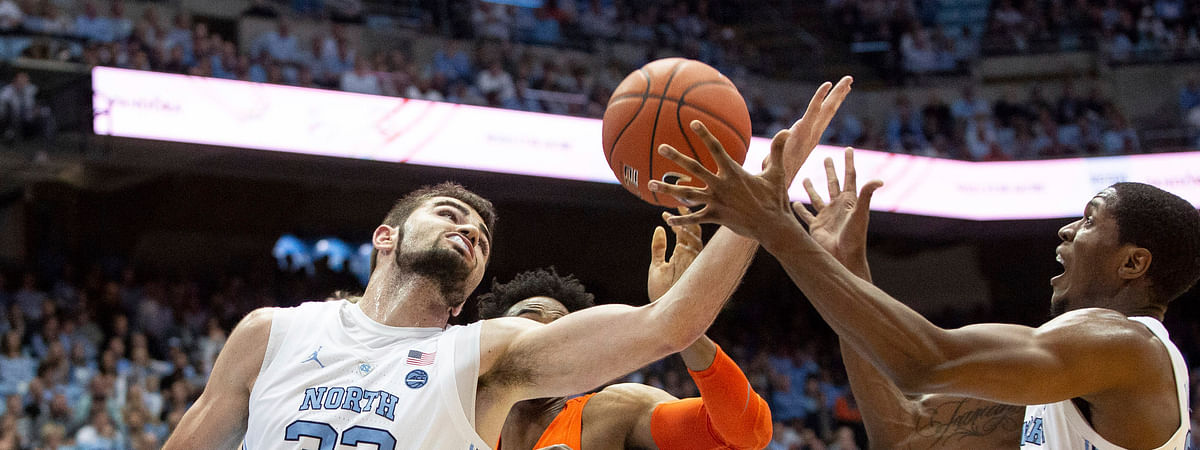 North Carolina's Luke Maye (32) and Kenny Williams battle Syracuse's Oshae Brissett  for a rebound Tuesday (Ben McKeown)