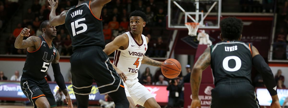 Virginia Tech's Nickeil Alexander-Walker looks to pass the ball while guarded by Miami's Zach Johnson, Ebuka Izundu and Chris Lykes during a game on March 8, 2019. (Matt Gentry/The Roanoke Times via AP)
