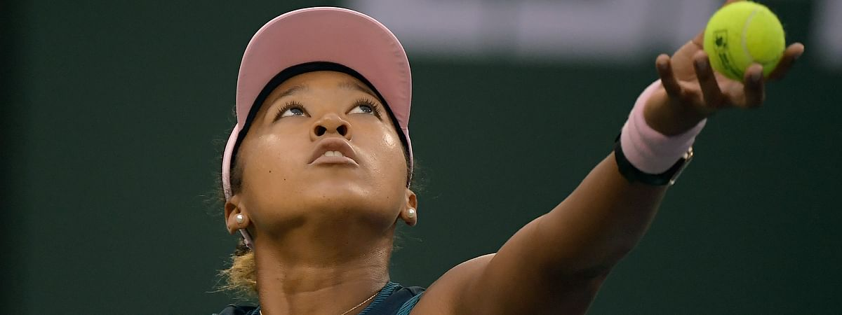 Naomi Osaka, of Japan, serves to Danielle Collins at the BNP Paribas Open tennis tournament Monday, March 11, 2019, in Indian Wells, Calif. (AP Photo/Mark J. Terrill)