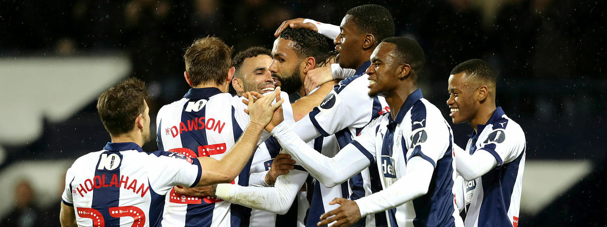 West Bromwich Albion's Kyle Bartley, center, celebrates with teammates after scoring against Brighton & Hove, Wednesday, Feb. 6, 2019. (Aaron Chown/PA via AP)