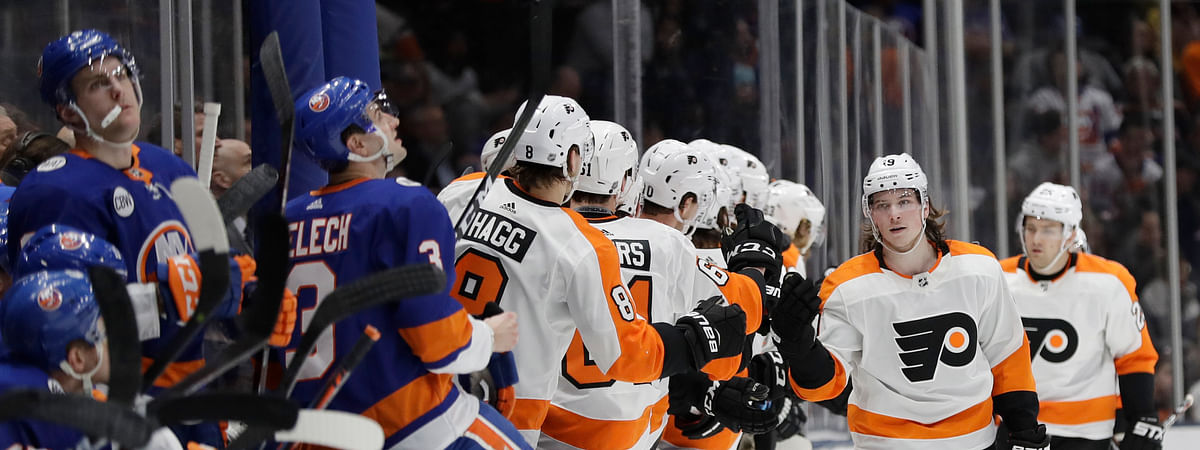 Islanders bench looks on as Flyers celebrate a goal Saturday in Long Islander (Frank Franklin III)