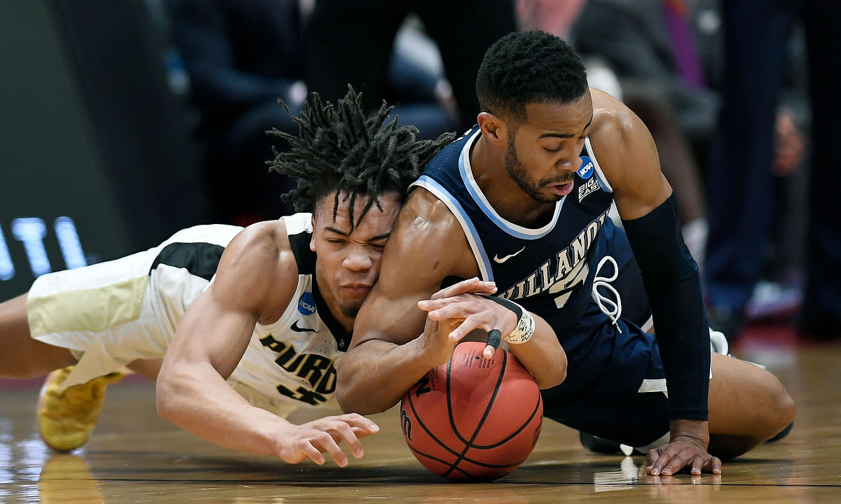 Purdue's Carsen Edwards (left) and Villanova's Phil Booth dive for a loose ball Saturday (Jessica Hill)