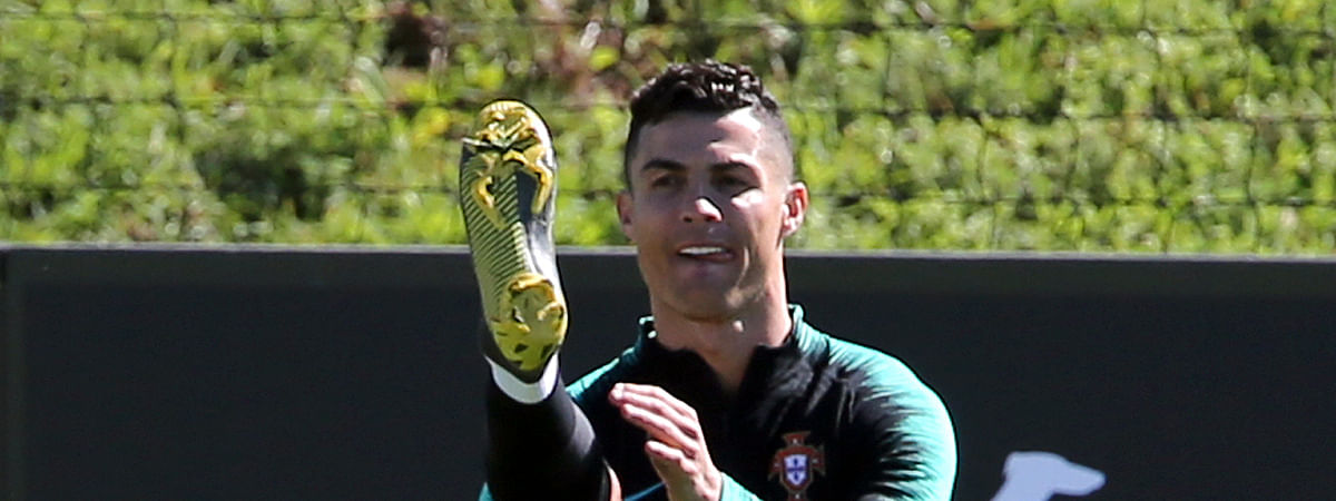 Cristiano Ronaldo stretches during a training session of the Portuguese soccer team on March 19, 2019.