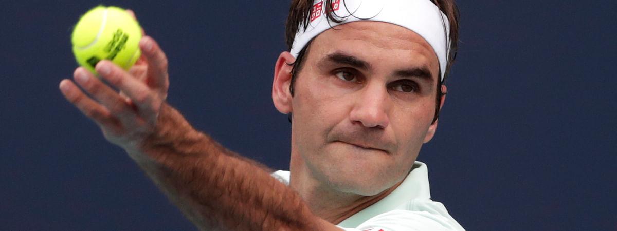 Roger Federer, of Switzerland, serves to Filip Krajinovic, of Serbia, during the Miami Open tennis tournament on March 25, 2019.