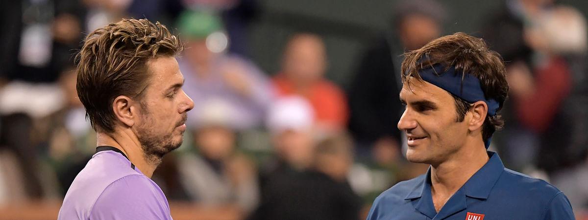 Stan Wawrinka (left) ongratulates Roger Federer after their match Tuesday (Mark J. Terrill)